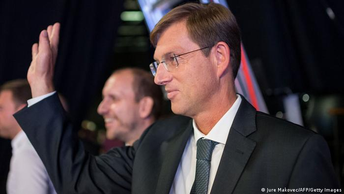 Miro Cerar, president of the Miro Cerar Party, waves during a TV face-off in Ljubljana, Slovenia on July 10, 2014. AFP Jure Makovec/AFP/Getty Images