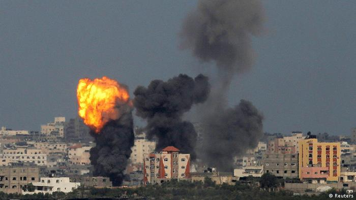 An explosion is seen in the northern Gaza Strip after an Israeli air strike July 13, 2014. REUTERS/Ammar Awad