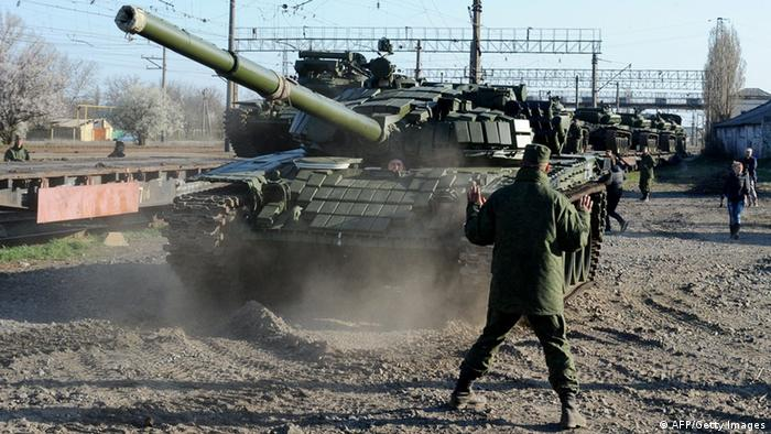 Russian soldiers unload trainload of their modified T-72 tanks after their arrival in Gvardeyskoe railway station near the Crimean capital Simferopol, on March 31, 2014. The Crimean crisis has sparked the most explosive East-West confrontation since the Cold War and fanned fears in Kiev that Russian President Vladimir Putin now intends to push his troops into southeast Ukraine. AFP PHOTO / OLGA MALTSEVA (Photo credit should read OLGA MALTSEVA/AFP/Getty Images)