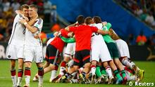 Germany's Thomas Mueller (L) and teammate Bastian Schweinsteiger embrace as they celebrate their win against Argentina during their 2014 World Cup final at the Maracana stadium in Rio de Janeiro July 13, 2014. REUTERS/Michael Dalder (BRAZIL - Tags: SOCCER SPORT WORLD CUP)