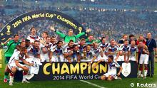 Germany's players pose for pictures as they celebrate with their World Cup trophy after winning their 2014 World Cup final against Argentina at the Maracana stadium in Rio de Janeiro July 13, 2014. REUTERS/Michael Dalder (BRAZIL - Tags: SOCCER SPORT WORLD CUP TPX IMAGES OF THE DAY) TOPCUP