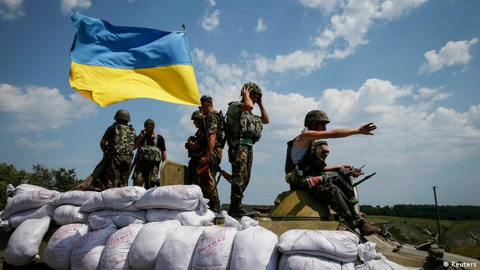 Soldiers with a Ukraine flag in the country's east