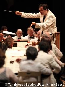 Andris Nelsons, conducting on stage in Tanglewood