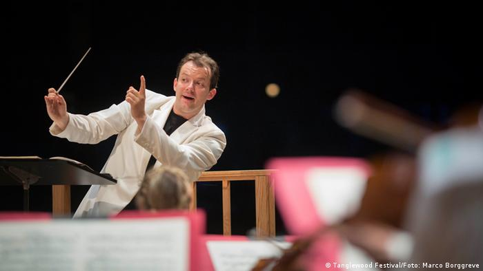 Andris Nelsons, conducting on stage