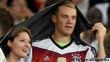 Goalkeeper Manuel Neuer (R) of Germany and girlfriend Kathrin Gilch celebrate after winning the FIFA World Cup 2014 final soccer match between Germany and Argentina at the Estadio do Maracana in Rio de Janeiro, Brazil, 13 July 2014. Photo: Marcus Brandt/dpa (RESTRICTIONS APPLY: Editorial Use Only, not used in association with any commercial entity - Images must not be used in any form of alert service or push service of any kind including via mobile alert services, downloads to mobile devices or MMS messaging - Images must appear as still images and must not emulate match action video footage - No alteration is made to, and no text or image is superimposed over, any published image which: (a) intentionally obscures or removes a sponsor identification image; or (b) adds or overlays the commercial identification of any third party which is not officially associated with the FIFA World Cup) EDITORIAL USE ONLY