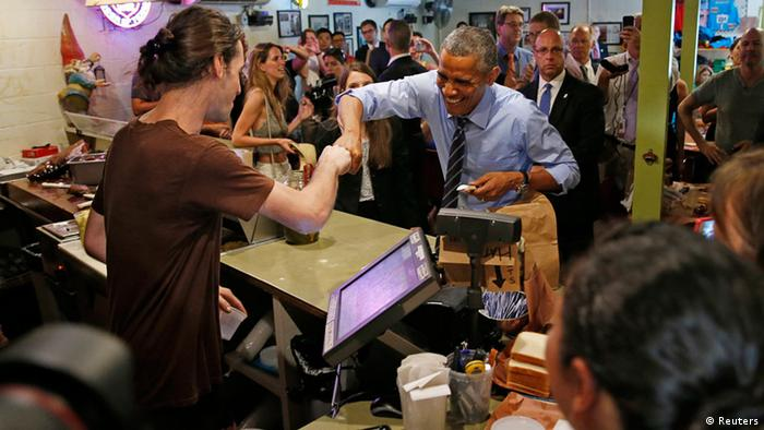 Barack Obama fist-bumps the cashier after paying for his order at Franklin Barbecue in Austin, Texas (Photo: REUTERS/Kevin)