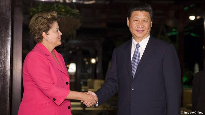Chinese President Xi Jinping meets with Brazilian President Dilma Rousseff in Durban, South Africa, in 2013.