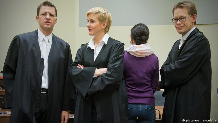 Zschäpe pictured with her back to her lawyers