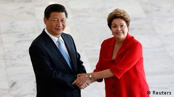 Brazil's President Dilma Rousseff (R) shakes hands with China's President Xi Jinping before a meeting on the sidelines of the 6th BRICS summit at the Planalto Palace in Brasilia July 17, 2014.
