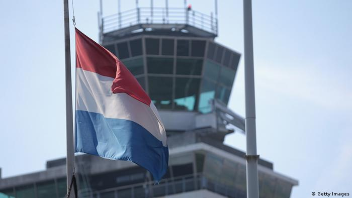 An air traffic control tower with a Dutch flag Photo: Christopher Furlong/Getty Images