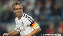 (File) Germany's Philipp Lahm reacts during the Group C World Cup 2014 qualifying match between Germany and Faroe Islands at AWD Arena in Hanover, Germany, 07 September 2012. Photo: Friso Gentsch/dpa (zu dpa «Kapitän Lahm tritt als Nationalspieler zurück» am 18.07.2014) +++(c) dpa - Bildfunk+++