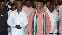 Indian actor Rajinikanth with PM Modi (AFP/Getty Images)