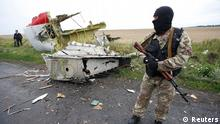 Pro-Russian separatist standing near the crash site of Malaysia Airline Flight MH17