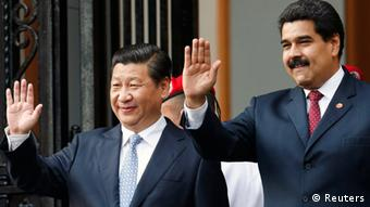 China's President Xi Jinping (L) and Venezuela's President Nicolas Maduro wave to supporters during a ceremony at the National Pantheon in Caracas July 20, 2014. Xi is on a two-day official visit to Venezuela.