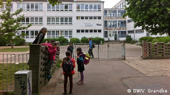 Students outside the school in Halle