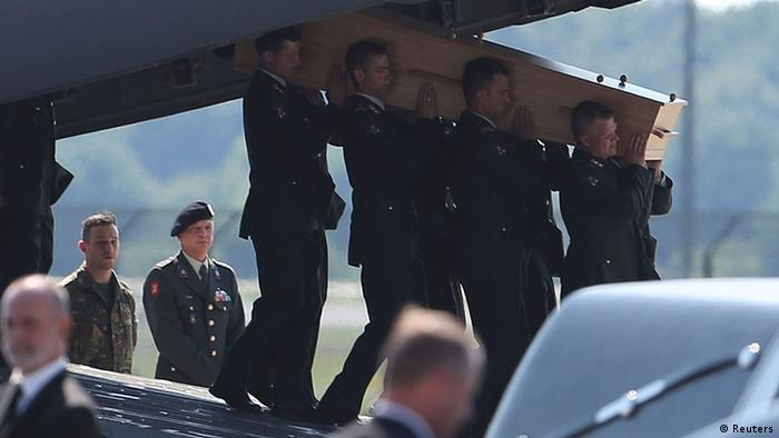 A coffin of one of the victims of Malaysia Airlines MH17 downed over rebel-held territory in eastern Ukraine, is carried from an aircraft during a national reception ceremony at Eindhoven airport July 23, 2014 (Photo: REUTERS/Francois Lenoir)
