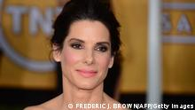 Actress Sandra Bullock attends the 20th annual Screen Actors Guild Awards, January 18, 2014 at the Shrine Auditorium in Los Angeles, California. AFP PHOTO / FREDERIC J. BROWN (Photo credit should read FREDERIC J. BROWN/AFP/Getty Images)