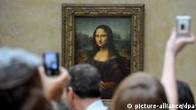 epa03156585 (FILE) A file picture dated 07 April 2011 shows visitors crowding and taking pictures of Leonardo da Vinci's painting 'La Gioconda (Mona Lisa)' at the Louvre Museum in Paris, France. According to the Art Newspaper on 23 March 2012, the Louvre Museum in Paris was the most visited art museum in the world in 2011. Nearly 8.9 million people visited the French venue. This is a five per cent increase on last year, according to the paper's poll. EPA/HORACIO VILLALOBOS +++(c) dpa - Bildfunk+++