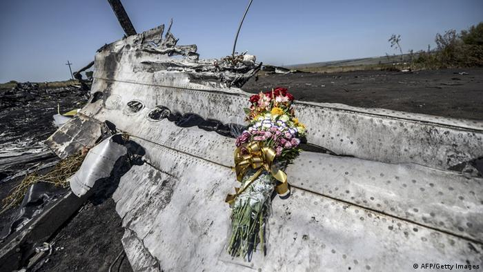 Flowers laid on a piece of the Malaysia Airlines plane MH17