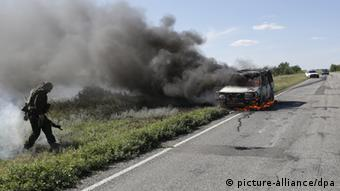 A car burning by the side of the road. (Photo: ITAR-TASS/ Valery Matytsin)