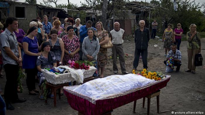 Ukraine Lugansk Zerstörung mit Artillerie zivile Opfer Zivilisten Kinder