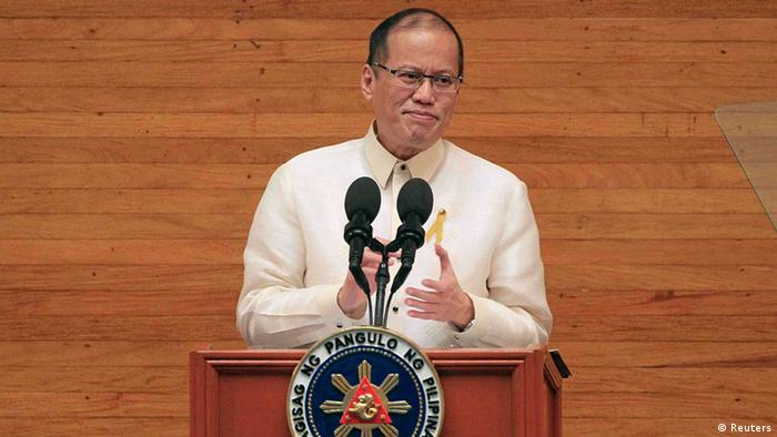Philippine President Benigno Aquino gestures as he delivers his fifth State of the Nation Address (SONA) during the joint session of the 16th Congress at the House of Representatives of the Philippines in Quezon city, metro Manila July 28, 2014. The biggest political crisis that Aquino has faced in four years in power could damage his image as a crusader against corruption and undermine his ability to deliver on reforms to sustain strong economic growth. The Supreme Court this month declared partly illegal a 145 billion pesos ($3.34 billion) economic stimulus fund that Aquino created in 2011 from budget savings, sparking a storm of controversy that has distracted the government from its work.