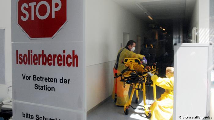 Stop sign warning at entrance to isolation station at Hamburg Eppendorf university clinic
