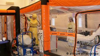 Patient being treated at inside the isolation station