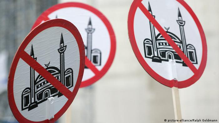 Signs showing a mosque crossed out during a street protest. Archive photo from 2014.