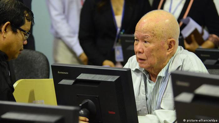 An Extraordinary Chambers in the Courts of Cambodia (ECCC), handout photograph shows former Khmer Rouge Head of State Khieu Samphan (R), in the courtroom at the ECCC, in Phnom Penh, Cambodia, 30 July 2014 (EPA/NHET SOK HENG / ECCC)