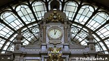 A picture of Antwerp central station's clock.