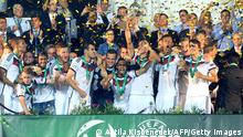 Germany's players celebrate with the trophy after the final football match Portugal vs Germany at the UEFA Under-19 European Championship in the Szusza Ferenc stadium in Budapest on July 31, 2014. Germany won the final 1-0. AFP PHOTO / ATTILA KISBENEDEK (Photo credit should read ATTILA KISBENEDEK/AFP/Getty Images)