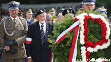 epa04337656 President of the World Association of the Home Army (AK) Leszek Zukowski (C) lays a wreath at the Monument to Polish Underground State and Polish Home Army during main celebrations marking the 70th anniversary of the Warsaw Uprising in Warsaw, Poland, 01 August 2014. The Warsaw Uprising, a major World War II operation by the Polish resistance Home Army to liberate Warsaw from Nazi Germany, broke out on 01 August 1944 and continued for 63 days, claiming the lives of 150,000 to 200,000 civilians and about 18,000 insurgents. After the failure of the uprising, the Nazis expelled the remaining inhabitants from the city and methodically blew it up, destroying it almost completely. EPA/LESZEK SZYMANSKI POLAND OUT
