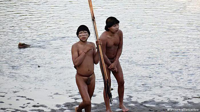 A handout photograph made available by the Brazil's National Indian Foundation (FUNAI) on 31 July 2014 shows a group of indigenous people from, until then, an uncontacted tribe, at Alto Envira, Acre State, Amazon, Brazil, 30 June 2014. EPA/Brazil's National Indian Foundation .