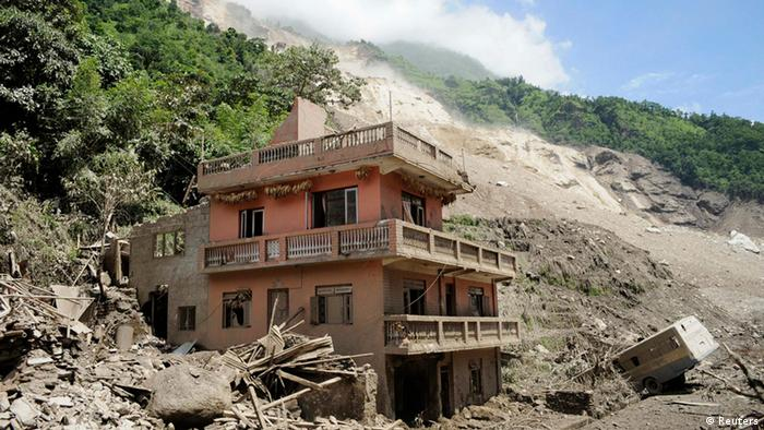 A house damaged by a landslide is seen in A massive landslide triggered by heavy rains in northeast Nepal on Saturday has killed at least eight people, injured 40 and buried dozens of homes, officials said. REUTERS/Dipesh Shrestha
