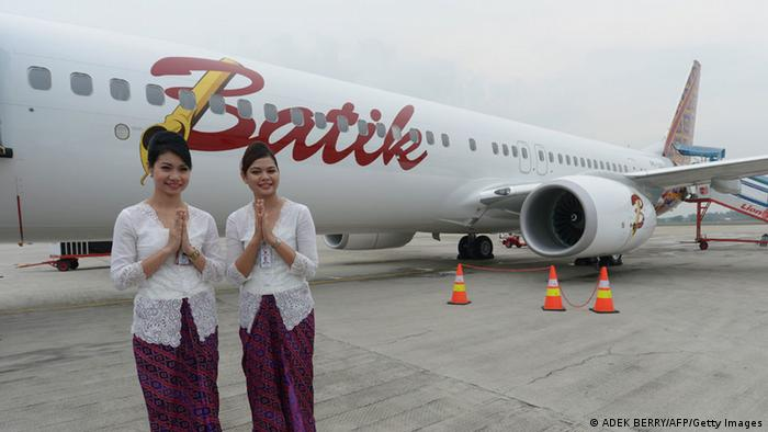 Two Indonesian air hostess stand next to a Boeing 737-900 plane of the new Indonesian airline Batik Air, a subsidiary of Lion Air is parked at the Soekarno-Hatta airport during the launching ceremony in Tangerang in the outskirt of Jakarta on April 25, 2013 (Photo: BERRY/AFP/Getty Images)