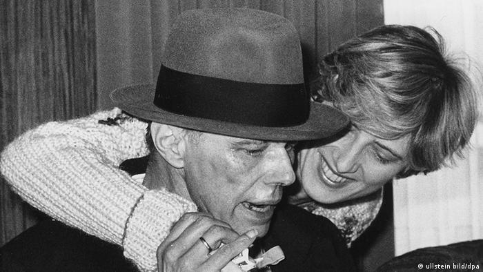 Petra Kelly hugging Joseph Beuys