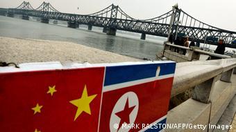Флаги Китая и КНДР