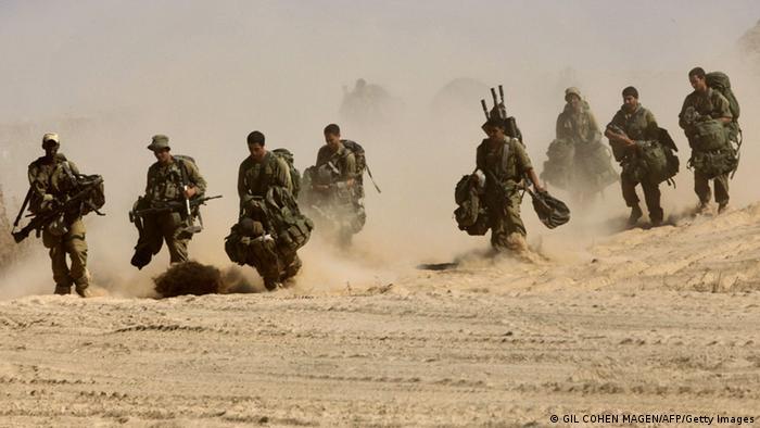 troops walking copyright: GIL COHEN MAGEN/AFP/Getty Images