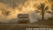 An Israeli Merkava tank rolls back from the Gaza Strip to an army deployment near Israel's border with the Palestinian enclave on August 4, 2014. Israel insisted there will be no end to its bloody military campaign in Gaza without achieving long-term security for its people, shunning increasingly vocal world demands for a truce. AFP PHOTO / JACK GUEZ (Photo credit should read JACK GUEZ/AFP/Getty Images)