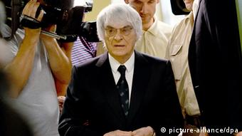F1 head Bernie Ecclestone departs from court