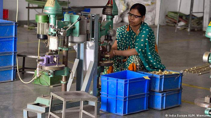 An Indian woman works at the India Europe Al company