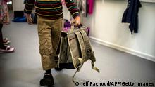 A boy walks with his satchel as he arrives for the first day of school following the summer holidays on September 3, 2013 in Lyon. AFP PHOTO / JEFF PACHOUD (Photo credit should read JEFF PACHOUD/AFP/Getty Images)