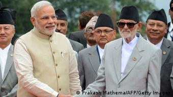 Nepalese Prime Minister Sushil Koirala (R) shakes hands with Indian Prime Minister Narendra Modi on his arrival at Tribhuvan International Airport in Kathmandu on August 3, 2014 (Photo: PRAKASH MATHEMA/AFP/Getty Images)