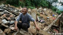 REFILE - CORRECTING DAY IN SECOND SENTENCE A man who lost six children cries over the debris of his house at the earthquake zone of Longtoushan town, Ludian county, Zhaotong, Yunan province, August 5, 2014. An earthquake in China on the weekend triggered landslides that have blocked rivers and created rapidly growing bodies of water that could unleash more destruction on survivors of the disaster that killed 410 people, state media reported on Tuesday. Picture taken August 5, 2014. REUTERS/Stringer (CHINA - Tags: DISASTER ENVIRONMENT SOCIETY TPX IMAGES OF THE DAY) CHINA OUT. NO COMMERCIAL OR EDITORIAL SALES IN CHINA