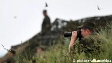 ITAR-TASS: KEMEROVO REGION, RUSSIA. JUNE 26, 2014. Units of the Central Military District of the Russian Armed Forces take part in a military exercise at Yugra military range. (Photo ITAR-TASS/ Yevgeny Kurskov)