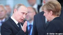 Merkel Putin Symbolbild