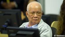 In this handout photo courtesy of the ECCC, Cambodia's former Khmer Rouge President Khieu Samphan sits at the Extraordinary Chambers in the Courts of Cambodia (ECCC) as his verdict is delivered on the outskirts of Phnom Penh August 7, 2014. The U.N.-backed tribunal in Cambodia sentenced the top two surviving cadres of the Khmer Rouge regime to life in jail on Thursday after finding them guilty of crimes against humanity for their part in the 1970s killing fields revolution. REUTERS/Mark Peters/ECCC/Handout via Reuters (CAMBODIA - Tags: POLITICS CIVIL UNREST CRIME LAW) ATTENTION EDITORS - THIS PICTURE WAS PROVIDED BY A THIRD PARTY. REUTERS IS UNABLE TO INDEPENDENTLY VERIFY THE AUTHENTICITY, CONTENT, LOCATION OR DATE OF THIS IMAGE. FOR EDITORIAL USE ONLY. NOT FOR SALE FOR MARKETING OR ADVERTISING CAMPAIGNS. NO SALES. NO ARCHIVES. THIS PICTURE WAS PROCESSED BY REUTERS TO ENHANCE QUALITY. AN UNPROCESSED VERSION WILL BE PROVIDED SEPARATELY