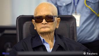 Former Khmer Rouge leader ''Brother Number Two'' Nuon Chea (C) sits at the Extraordinary Chambers in the Courts of Cambodia (ECCC) as his verdict is delivered on the outskirts of Phnom Penh August 7, 2014 in this handout provided by ECCC.
