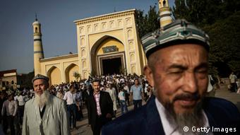 Uyghur men leave the Id Kah Mosque following the Eid prayers on July 29, 2014 in old Kashgar, Xinjiang Province, China (Photo: Kevin Frayer/Getty Images)